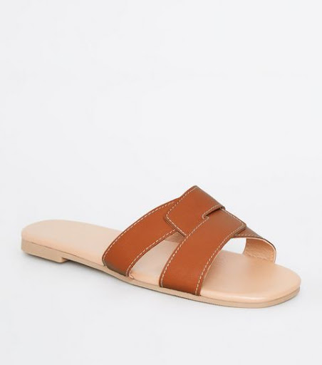 d433940e0abca A pair of tan leather sliders always look expensive—whether you go for a  pair of Hermès Oran sandals or Saint Laurent Tribute Nu Pieds or a  high-street ...