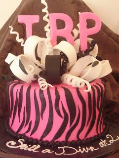 Animal print creative unique hot pink and black fondant zebra stripe, monogram and edible bow girl's or lady's birthday cake design idea picture