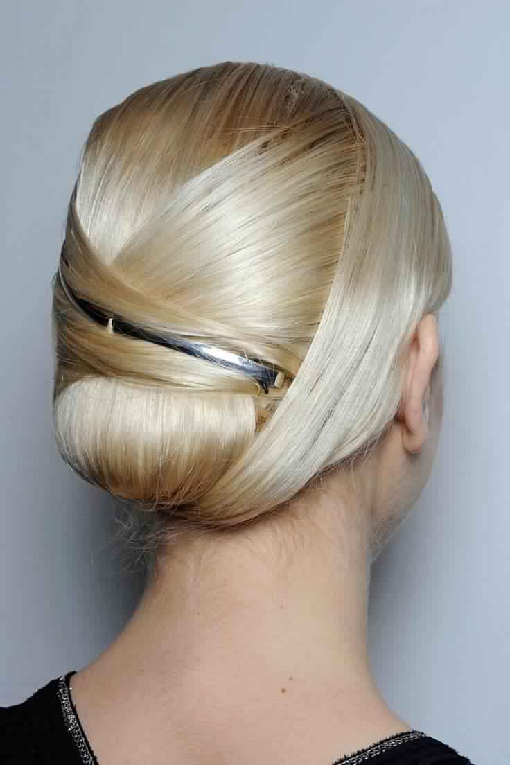 Sleek Updo Hairstyle with Metallic Accessory