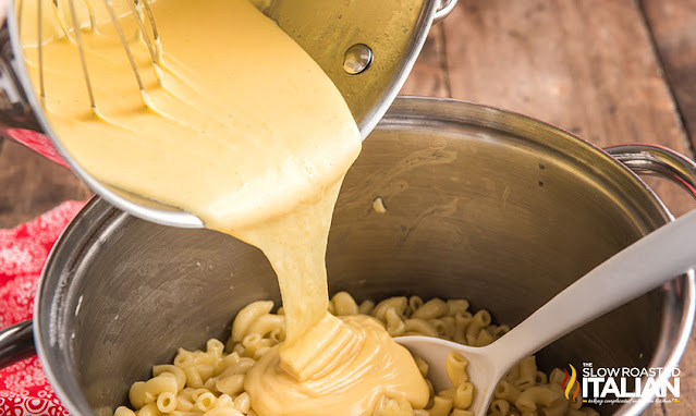 Chick fil a mac n cheese pouring cheese sauce