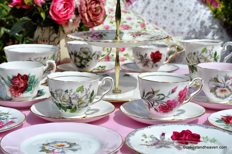 pink and green floral mismatched vintage tea set for six with teacup top cake stand