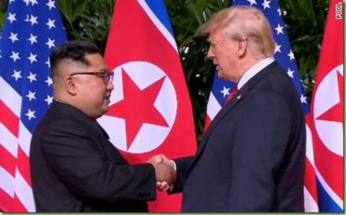 180611204213-02-trump-kim-handshake-0611-screengrab-large-169