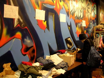 Guests can help themselves to tables of clothing donations.