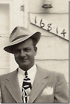 GOULD_H Norman in a hat in from of 16814 Winston_1950_DetroitMI