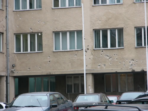 Bihac - University building with bullet holes. The University of Bihac was opened in 1997.