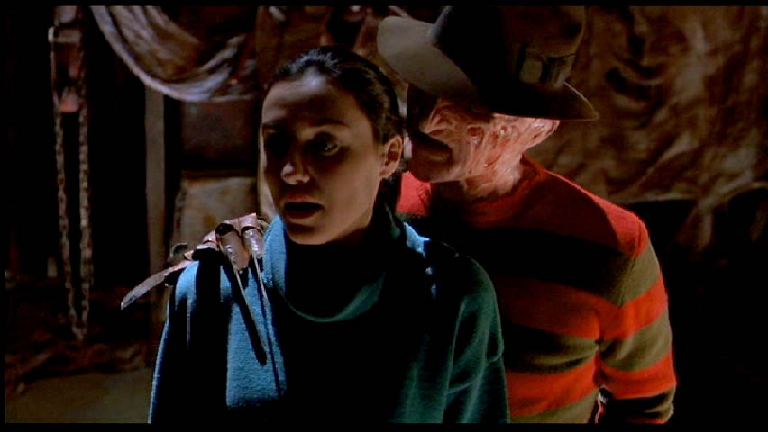 Freddy whispers sweet nothings to maggie.