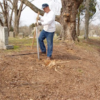 Owen Gleaves digs through the tree roots to place a secure fence post for new fence Gleaves-Clements Cemetery Hermitage, Tennessee
