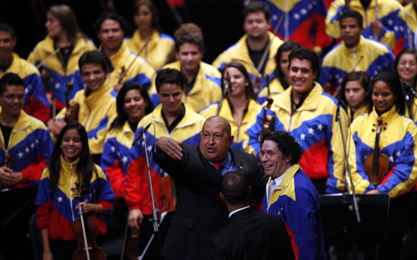 President Chávez and Gustavo Dudamel at the opening concert of the Community of Latin American and Caribbean States Summit, held in Caracas on December 2, 2011. Associated Press photo.