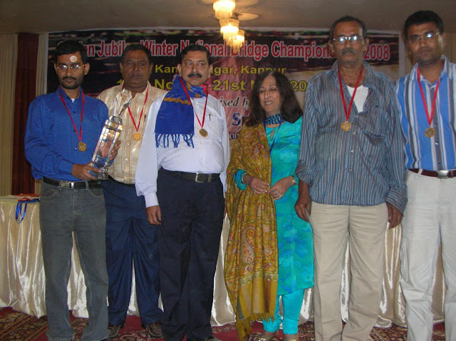 2008 Winter Nationals - The Board-a-Match Winners of the Mohan Sicka Trophy seen here with Chief Guest Mrs. Kiran Nadar From L to R: Sumit Mukherjee, Rana Roy, Amarnath Banerjee, Mrs. Kiran Nadar, Manas Mukherjee & Debbrata Majumder