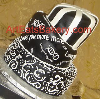 Three tier black and white whimsical mad hatter modern custom wedding cake with stripes, XOXO, love you more and curlicue design
