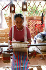 2) This picture shows one of the dedicated weavers in the community. Everyday these weavers work hard to produce beautiful goods which provide a year-round source of income.