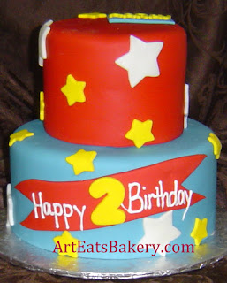 Two tier red, blue and yellow stars second birthday cake