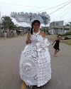 O.M.G!!! See Wedding dress that was made with Cups..Spoons..Plates..Forks and Knives