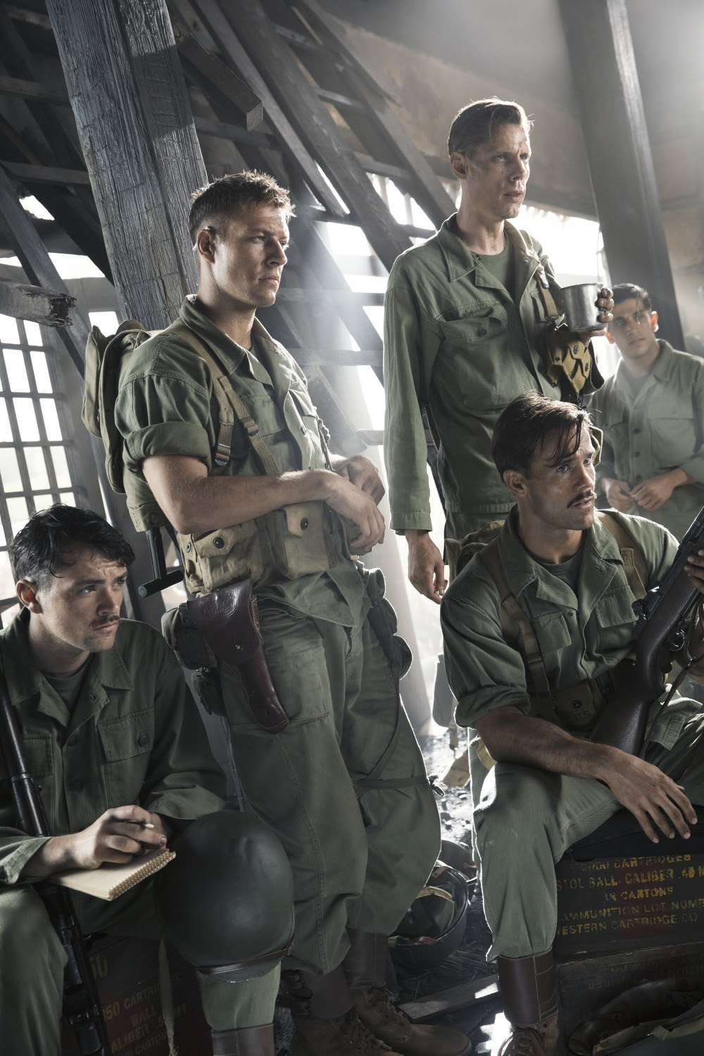 "(L-R) James Pinnick (Jacob Warner), Smitty Ryker (Luke Bracey), Andy Walker aka ""Ghoul"" (Goran Kleut), Milt Zane aka ""Hollywood"" (Luke Pegler) and Vito Rinelli (Firass Dirani) in HACKSAW RIDGE. (Photo by Mark Rogers / Lionsgate)."