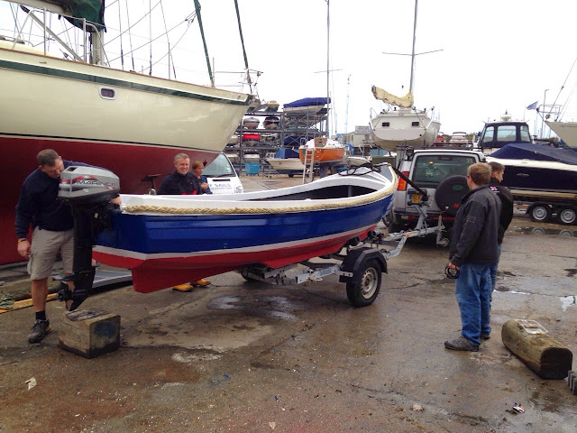 Paul Taylor inspects the stern of the boarding boat after maintenance - 2 November 2014.  Photo credit: Alex Evans