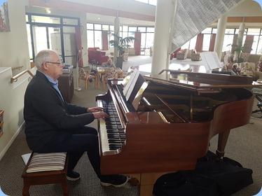 John Holster playing the Steinway grand piano.