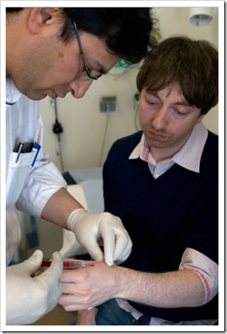 British scientist Dr. Mark Gasson getting a surgical implant in his left hand with an RFID microchip (March 16, 2009)