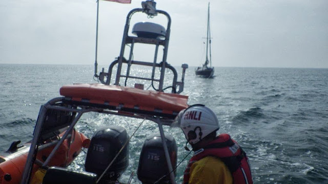Another view back to the towed yacht - 23 July 2013.  Photo credit: RNLI/Poole