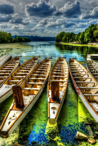 The Sea Awaits by Sarah Hauck - Transportation Boats ( water, clouds, blue, boats, parks, empty, cloudscape, canoe, lake, seascape )
