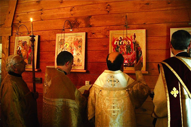 Vladyka blesses the icons with Holy Water in the Name of the Father, and the Son, and the Holy Spirit.  Amen.
