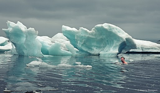 Wim Hof swimming in the waters of Iceland.