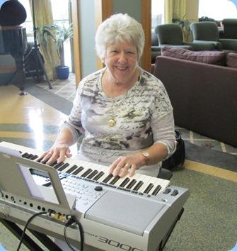 Barbara Powell playing her Yamaha Tyros 5. Photo courtesy of Diane Lyons.