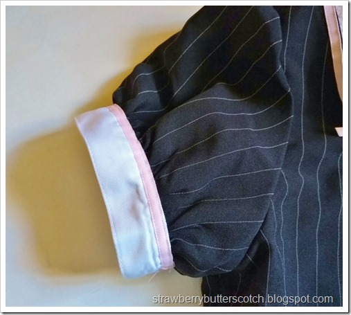 A close up of the sleeve.  Pink ribbon was added along the cuff of the puffed sleeve.  It looks so cute.