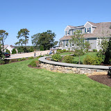 Gentle flow of stone walls, plant beds and grass