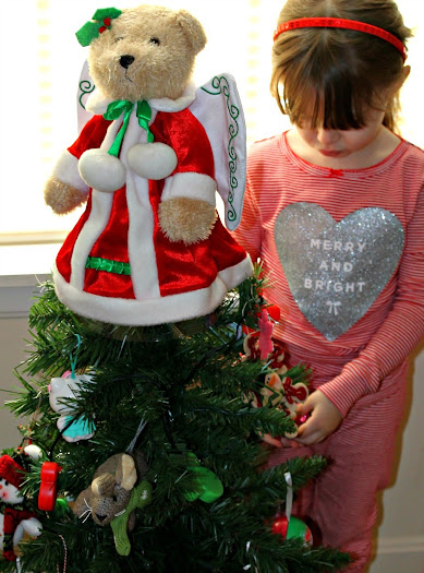 4 Holiday Traditions to start with your family this year - like letting kids decorate their own kid-friendly Christmas tree for their room #ChosenByKids