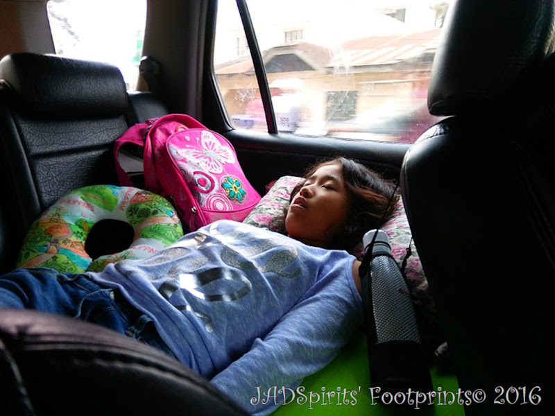 Daniz already fast asleep at her inflatable car bed