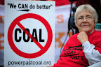 A protester rallies ahead of the Longview Coal Exports Hearing against the proposed Millennium Bulk Terminal which would export 44 million tons of coal annually to Asia.