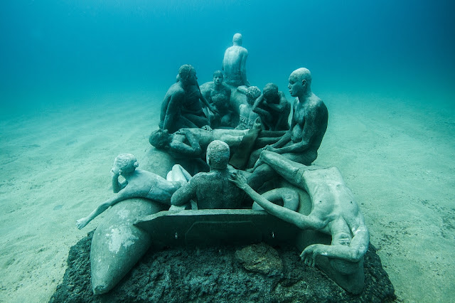 The Raft of Lampudesa. Museo Atlantico in Lanzarote, Spain - by artist Jason deCaires Taylor
