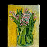 Hyacinths flowers in glass vase