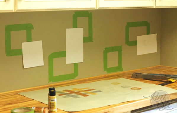 Laying out stencil pattern on wall