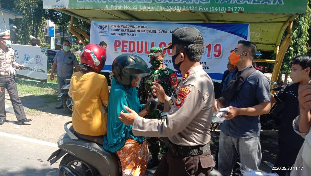 Kapolres dan DPD GoWa-Mo Takalar Kompak Gelar Aksi Sosial Berbagi Masker Cegah Covid-19