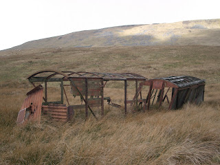dilapidated railway trucks once used as shelters