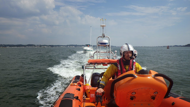 Poole ILB tows a motor vessel with fuel and engine problems back towards Rockley Point in Poole Harbour - 23 July 2014.  Photo credit: Dave Riley