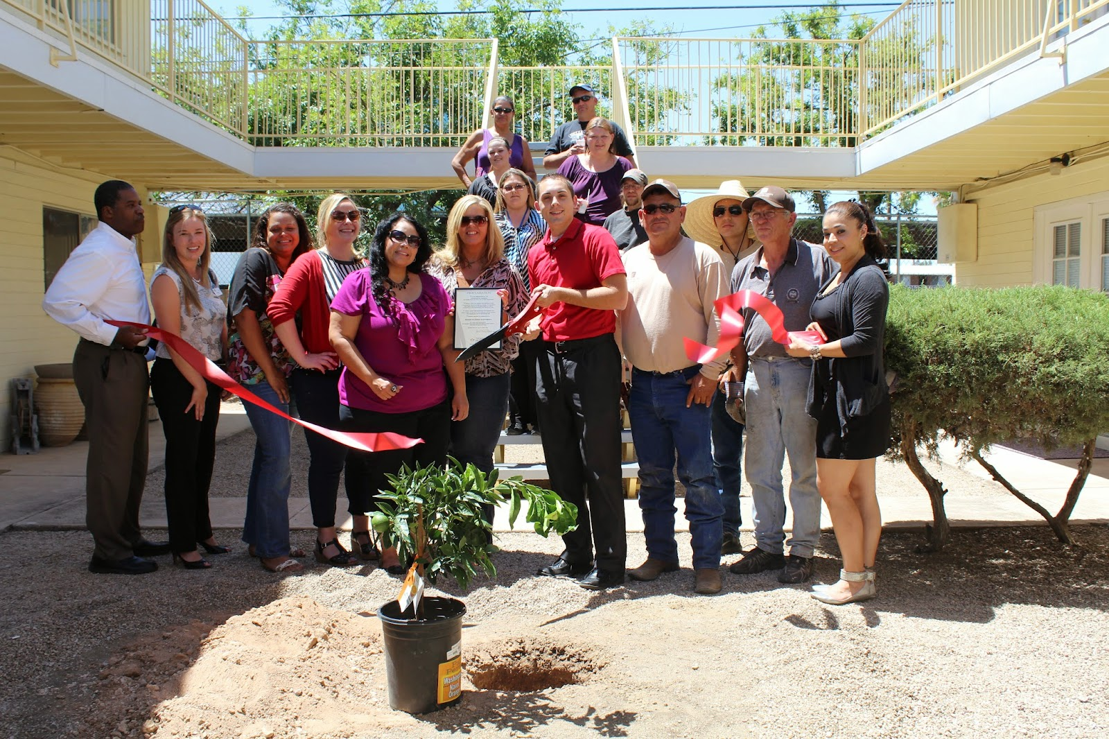 Grindstone Property Management and Orange Blossom Apartments are dedicated to helping Tucson residents find both affordable and comfortable housing, while also participating in activities benefiting the community.  We are planting this orange tree as a continued effort inour mission of going green and in celebration of the new management team.