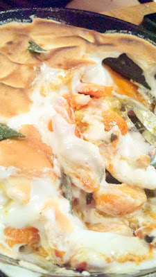 Baked butternut squash, marshmallows, fried sage created in a Sweet Potato Casserole style