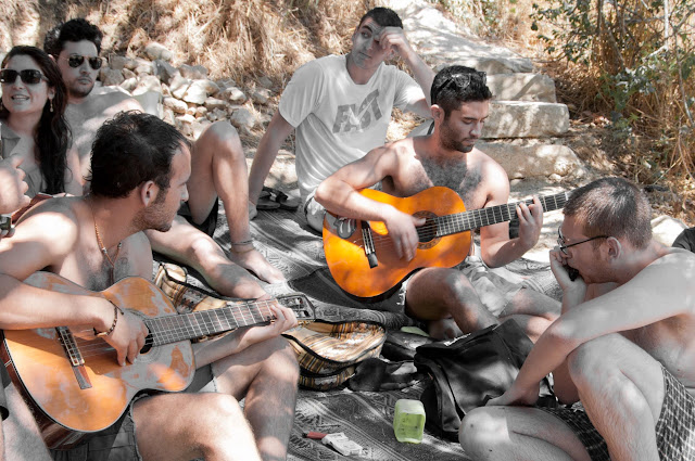 outdoors in Israel playing guitar