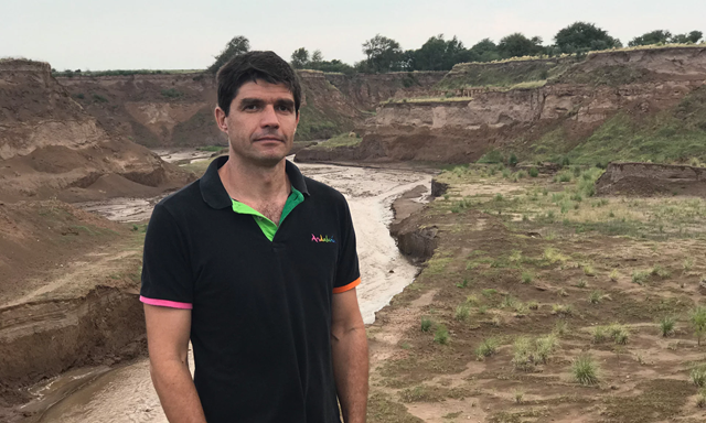 Alberto Panza, a 41-year-old cattle rancher, is one of the few holdouts refusing to lease his land to the giant soya-bean conglomerates that have largely replaced Argentina's small farmers. He stands in front of a ravine that was carved by the 'Rio Nuevo', which appeared overnight in 2015 in Argentina's central province of San Luis. Panza says, 'This used to be totally flat pasture land.' Photo: Uki Goñi / Guardian