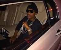 StarBoi Wizkid inside his porshe car