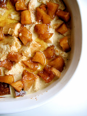 top down shot of caramelized apple bread pudding in a baking dish