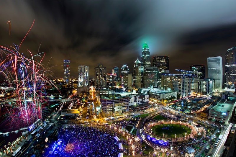 Thousands of people packed into Romare Bearden Park, in Charlotte, NC on New Year's Eve to welcome in 2016 and watch the fireworks, during the Crown Town Festival.  Charlotte Photographer - PatrickSchneiderPhoto.com