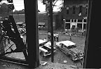 Scenes of 16th Street Baptist Church bombing aftermath on the morning of September 15, 1963. This view to the East is from the Sanctuary, immediately above the basement area where the bomb exploded. (photographer near car is Tony Faletta, then of Birmingham News.