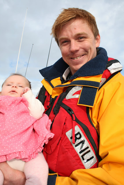 How could you not smile with such a bonny wee girl. ILB Mechanic Pete with Evalyn. 25 January 2014 Photo: RNLI Poole/Rob Inett