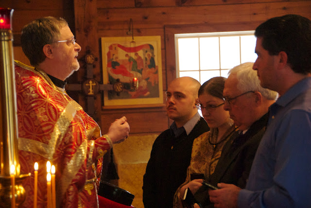Fr. John presents a prayer rope to each of the catechumen.