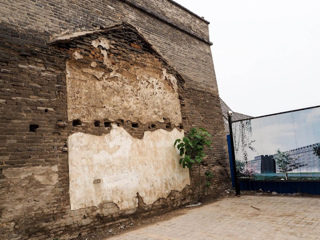 portion of ancient city wall with leftover marking from a building which had once been built against it