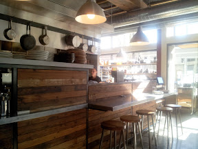 Tasty n Alder restaurant space, kitchen bar seating