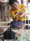 Shan man making Shan house with Shan tea pot